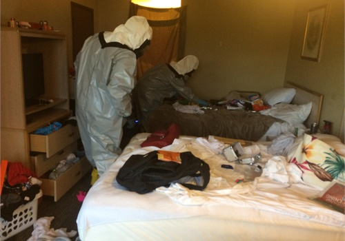 Authorities search the motel room where three Arlington, WA, officers were sickened while serving a warrant. Fentanyl is suspected. (Photo: Arlington PD/Facebook)