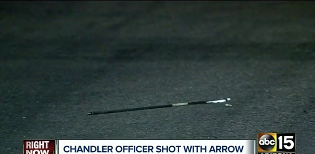 An arrow in the street at the scene where police say a Chandler, AZ, officer was shot by a suspect wielding a bow. (Photo: Screenshot from ABC15)