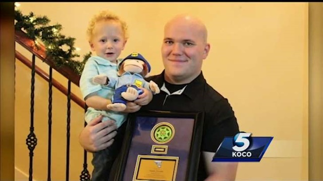 Cleveland County, OK, Sheriff's deputy Neil McMillin's bone marrow donation helped save a baby. He recently traveled to Texas to meet the now toddler named Kayden. (Photo: KOCO TV screen shot)