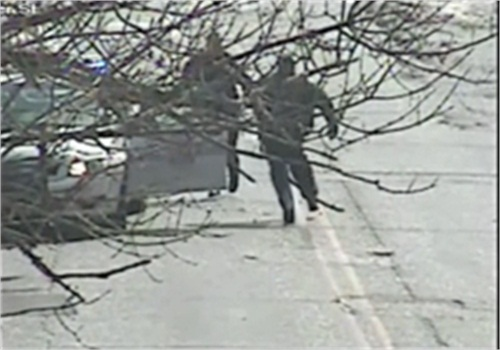 Still image from official Baltimore surveillance video shows man charging at officer right before officer opened fire.