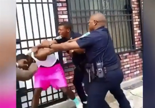 Screen grab of a widely circulated video showed Officer Arthur Williams repeatedly striking 26-year-old Dashawn McGrier with his fists and knee and taking him to the ground in front of an East Baltimore rowhouse.