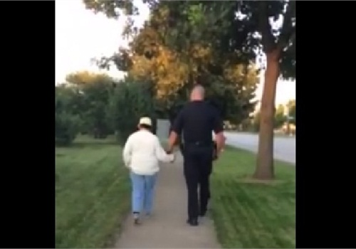 Bloomingdale officer walking with mentally disabled woman. (Photo: Facebook)