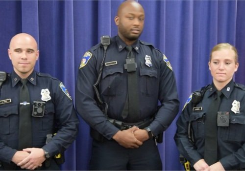 Baltimore officers show body-worn cameras at press conference. (Photo: screen shot from Baltimore Sun video)