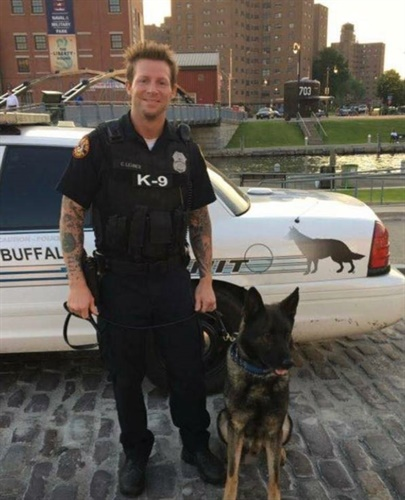 "Buffalo Officer Craig Lehner with his K-9 ""Shield."" Lehner went missing after a training exercise with the department's Underwater Recovery Team Friday. He is presumed dead. (Photo: Buffalo PD/Facebook)"
