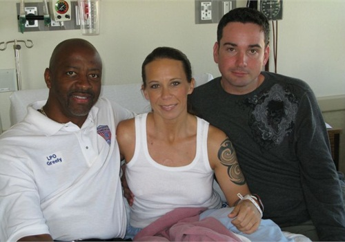 Kim Munley with husband Matt (right) and Walt Greely. Photo via AFGE/Flickr.