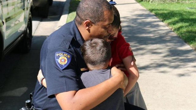 Round Rock, TX, police chief Allen Banks hug Ximena and another child during a visit. Ximena donated her allowance to Round Rock officers who are mourning the loss of Officer Charles Whites. (Photo: Round Rock PD/Facebook)
