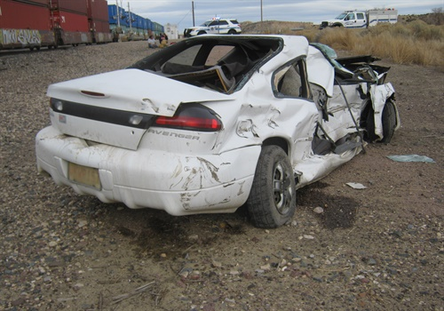 The car stuck on the tracks was struck by the train and damaged. (Photo: Arizona DPS)