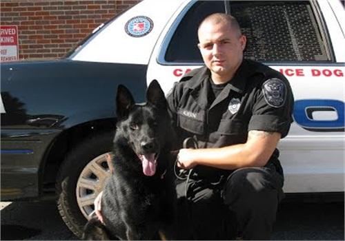 HandlerOfficer Chris Alberini with Dax (Photo: Ashland (Mass.) PD)