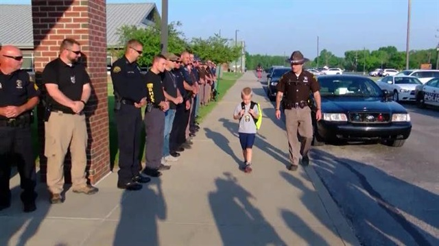 Dakota Pitts, the 5-year-old son of slain Terre Haute, IN, Officer Rob Pitts is escorted to school by his father's comrades. (Photo: WNDU screen shot)