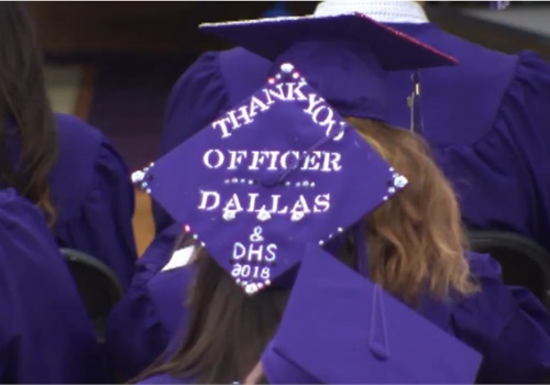 A graduating senior at Dixon High School honors SRO Mark Dallas. (Photo: Fox News Screen Shot)