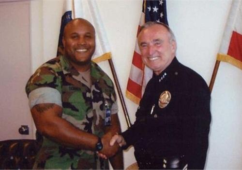 Dorner with former LAPD Chief William Bratton. Photo via Facebook.
