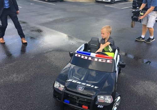 The Edinburgh Police Department, Bartholomew County Sheriff's Office, and Stinesville Police Department surprised a heartbroken five-year-old boy with a new electric police car after his was stolen. Image courtesy of Edinburgh PD / Facebook.