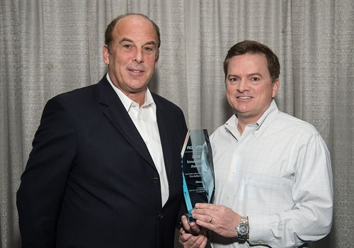 Elbeco's President & CEO David Lurio (left) and Vice President of Sales and Marketing David Burnette (right) receiving the NAUMD's Best Public Safety Product Innovation Award. (Photo: Elbeco)