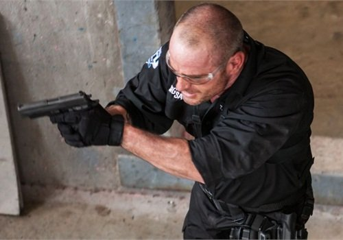 "SWAT operator clearing a room on ""Elite Tactical Unit: S.W.A.T."" Copyright Outdoor Channel 2013."