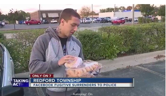 Fugitive Michael Zaydel surrendered to Redford, MI, police and gave them a dozen doughnuts after losing a Facebook bet. (Photo: WXYZ Screen Shot)