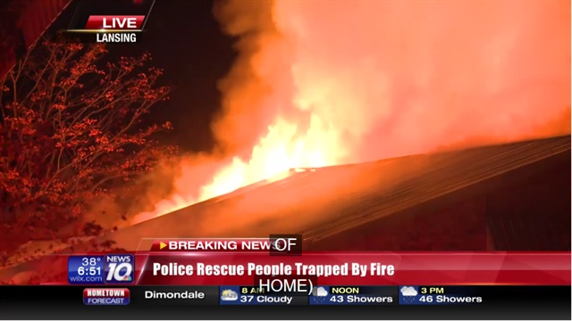 Lansing, MI, police officers rescued 15 students from this burning home early Monday morning. (Photo: WILX TV Screen Shot)