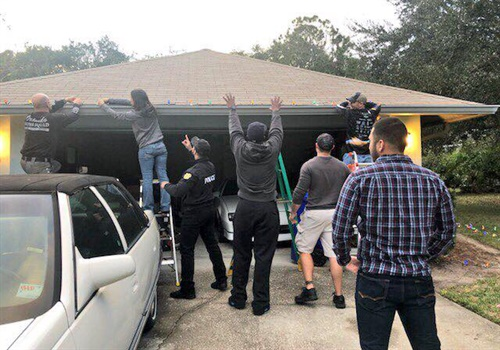 Officers with the Orlando (FL) Police Department visited the home of Officer Kevin Valencia to deliver some Christmas Cheer. Image courtesy of Orlando PD / Facebook.