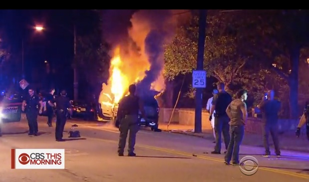 A police vehicle burns Monday night during rioting on the campus of Georgia Tech University. (Photo: Screen shot from CBS News)