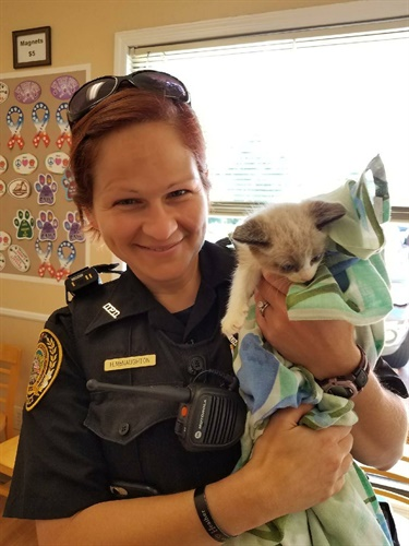Officer Heather McNaughton helped a family pick up its kitten from the vet. Photo: Duluth PD/Facebook