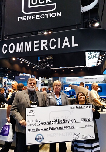 Bob Radecki, Glock national sales manager, Dianne Bernhard, C.O.P.S. executive director, and Cheryl Schultz. (Photo: Fred Mastison)