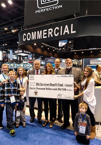 The Loftus-Errthum family accept check from Glock to the DEASBF with Richard Crock. Bob Radecki, Glock national sales manager presents check. (Photo: Fred Mastison)