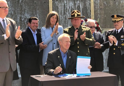 "Illinois Governor Bruce Rauner signed a bill on Monday to create a new Illinois Lottery scratch-off game with the proceeds ""funding police memorials, support for the families of officers killed or severely injured in the line of duty, and protective vest replacements for officers. Image courtesy of Governor Bruce Rauner / Facebook."