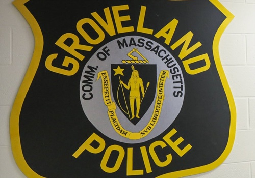 Officers with the Groveland (MA) Police Department had just rescued a 44-year-old hunter who had capsized a canoe on Parker River, when they found themselves in the same predicament. Image courtesy Groveland PD / Facebook.
