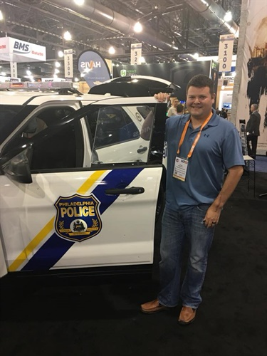 Philadelphia Police Officer Jesse Hartnett, who was shot in his vehicle in an ambush attack on January 7, 2016, shows the Hardwire armor kit on a Philadelphia Police vehicle. (Photo: Hardwire LLC.)