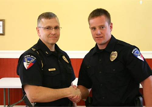 Officer Tyler Horn (right) of the Statesville (NC) Police Department was shot in the back Friday night and saved by his body armor. (Photo: City of Statesville)