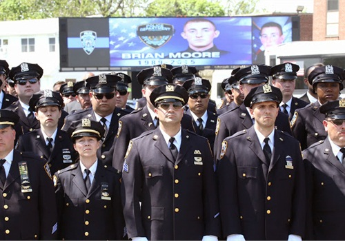 NYPD officers pay respects to their fallen comrade Brian Moore. (Photo: NYPD)