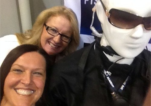 Police National Sales Manager Susan Freel (foreground) and Publisher Leslie Pfeiffer take a selfie in the Police SHOT Show booth (#11979) next to a mannequin wearing ESS eyewear.