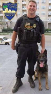Jacksonville K-9 officer Jeremy Mason was shot in the face during the pursuit of a bank robbery suspect. The suspect was killed in a subsequent shootout. Mason is in stable condition at a local hospital. (Photo: Jacksonville SO)