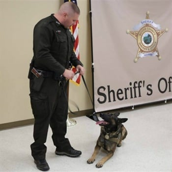 Boone County (IN) Sheriff's Deputy Jacob Pickett with K-9 partner Brick. Pickett was fatally shot during a foot pursuit Friday. (Photo: Boone County SO)