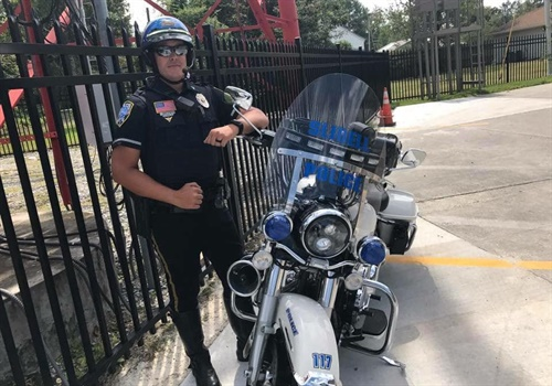 Officer Jason Seals was participating in the funeral escort on his patrol motorcycle when a vehicle unexpectedly pulled out in front of him, causing him to strike the vehicle and be ejected from his motorcycle, the Slidell (LA) Police Department said on Facebook. Image courtesy of Slidell PD / Facebook.