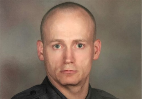 New York State Police Trooper Jeremy VanNostrand was in his personally owned vehicle outside of the state police barracks in Glen, NY, when his car was rear-ended and pushed into oncoming traffic, the agency said on Facebook. Image courtesy of NYSP / Facebook.