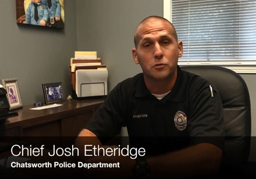 Screen grab taken from video of Chief Josh Etheridge explaining the actions of one of his officers who deployed a TASER on an 87-year-old woman holding a knife.