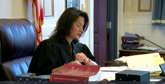 Judge Leslie Ghiz ruled in Cincinnati this morning that former University of Cincinnati police officer Ray Tensing cannot be tried again on murder charges in the officer-involved shooting of Samuel DuBose, but she stopped short of acquittal. (Photo: WCPO Screenshot)