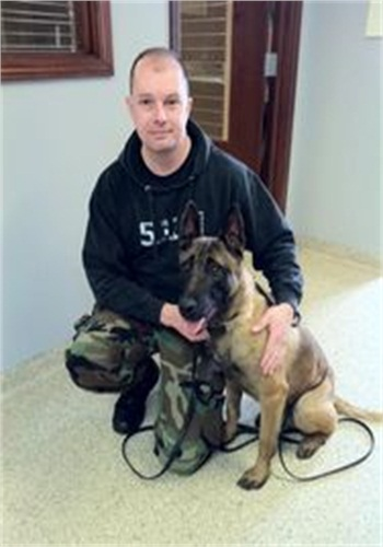 K-9 Karson reunited with his handler Officer Jerry Popp. After 61 days lost, the dog was 14 pounds lighter and mildly dehydrated but otherwise healthy. (Photo: Wilmington (Ohio) PD)