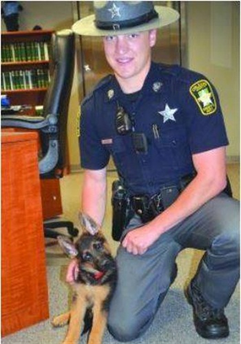 K-9 Kilo from the Orleans County Sheriff's Office, seen here as a puppy with his partner, Deputy Tyler Jacobs. (Photo: Facebook)