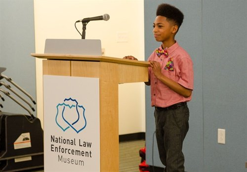 "The National Law Enforcement Museum hosted an event featuring Miguel Coppedge, 12-year-old author ofthe book ""Friendly Officers."" (Photo: NLEOMF)"