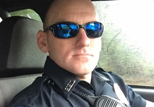 """Officer LaDean Byrd of the Petal (MS) Police Department saved a five-year-old boy from drowning, but he shirks the label of """"hero."""" Image courtesy of Petal PD / Facebook."""
