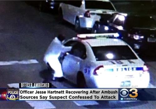 A surveillance camera captured video of Officer Jesse Hartnett being ambushed at a Philadelphia intersection. (Photo: KYW-TV screen shot)