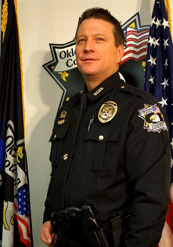 Mark Vaughan, a reserve deputy with the Oklahoma County Sheriff's Office, has been named the NRA's 2014 Officer of the Year.
