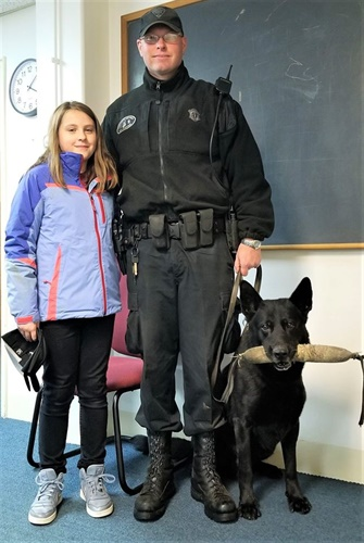 Olivia Feil bought treats for K-9 Tank and met the dog and his handler Trooper Thomas Janeczak. (Photo: Massachusetts State Police/Facebook)