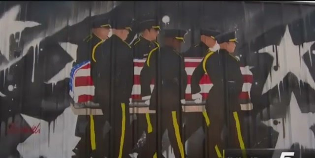 A Dallas bar owner may have to remove this mural honoring the officers killed in last year's sniper attack because its construction does not meet city code. (Photo: NBCDFW screenshot)