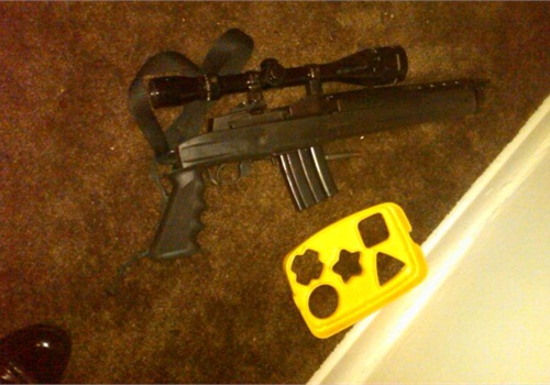 A sawed-off assault rifle lays next to a children's toy after a suspect's gunfight with officers. Photo: NYPD