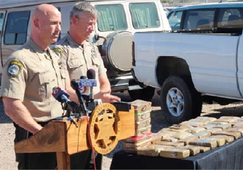 Pinal County Sheriff Paul Babeu (left) and Chief Deputy Steve Henry announce the seizure of $1.55 million of narcotics. Photo: PCSO