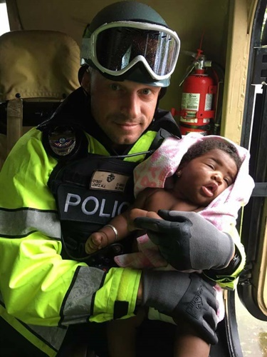 North Miami Beach officers rescued a mother and her baby Sunday from a home flooded by the storm surge of Hurricane Irma. (Photo: North Miami PD)