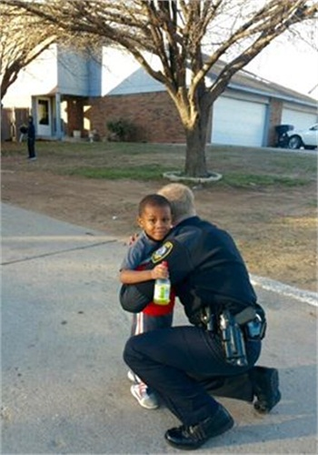 A little boy approched Officer Krieg Cook and asked for a hug. He got it. (Photo: Facebook)