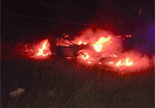 Cleveland County (OK) Sheriff's Deputy Kyle Turner risked jumping over downed power lines to save a man from this burning car. The deputy serves as a volunteer firefighter and has been trained in the dangers of downed power lines.